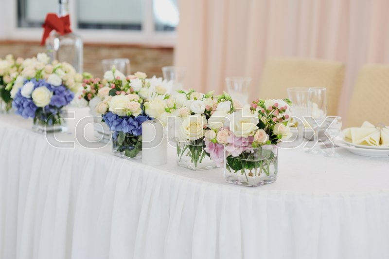 Stock image of 'Interior of a wedding banquet in restaurant, reception venue tables'