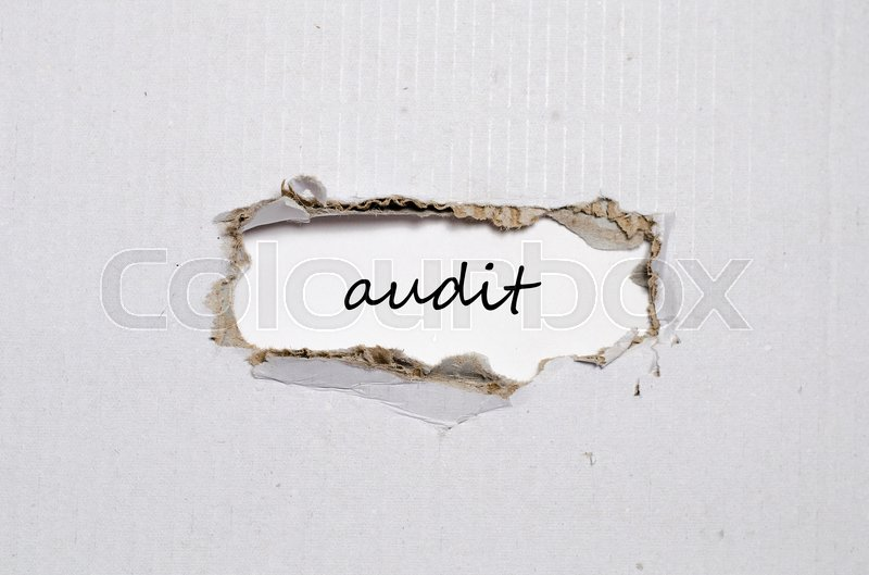 Stock image of 'The word audit appearing behind torn paper'