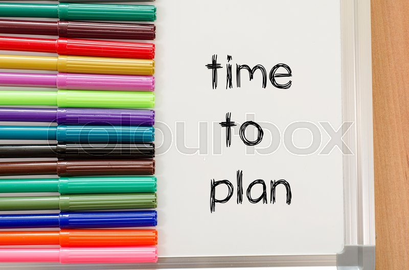 Stock image of 'Felt-tip pen and whiteboard on a wooden background and time to plan text concept'