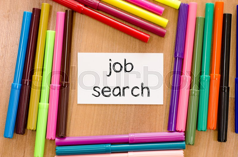 Stock image of 'Felt-tip pen and note on a wooden background and job search text concept'