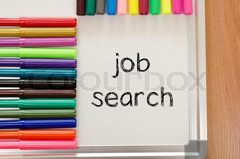 Stock image of 'Felt-tip pen and whiteboard on a wooden background and job search text concept'
