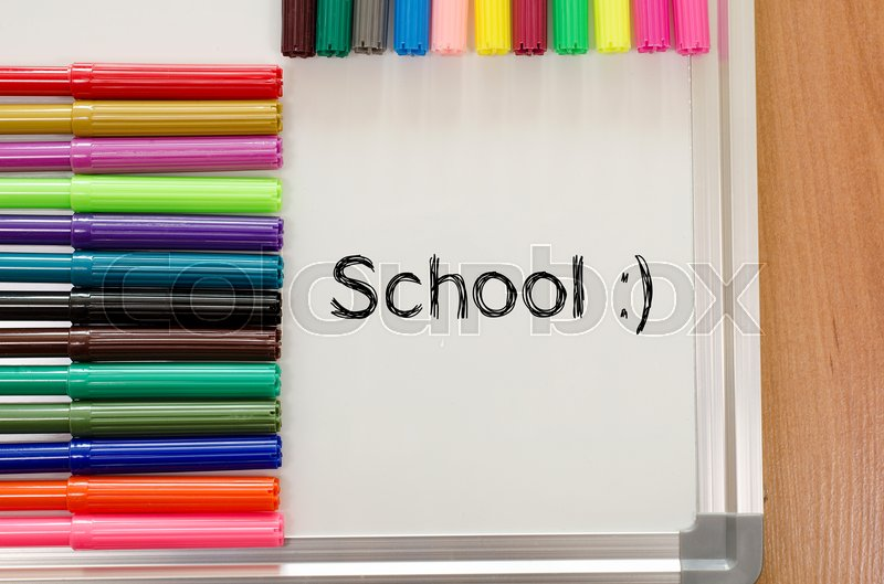 Stock image of 'Felt-tip pen and whiteboard on a wooden background and school text concept'