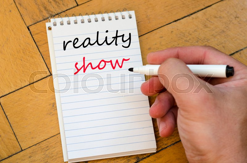 Stock image of 'Reality show text concept write on notebook'