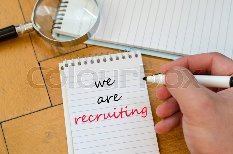Stock image of 'We are recruiting text concept write on notebook'