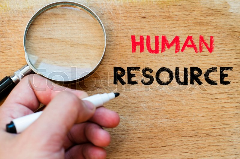 Stock image of 'Human hand over wooden background and human resource text concept'