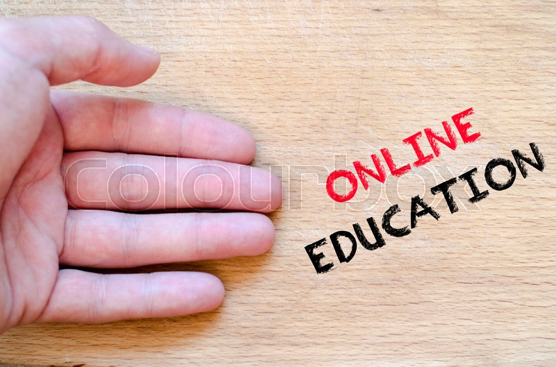 Stock image of 'Human hand over wooden background and online education text concept'