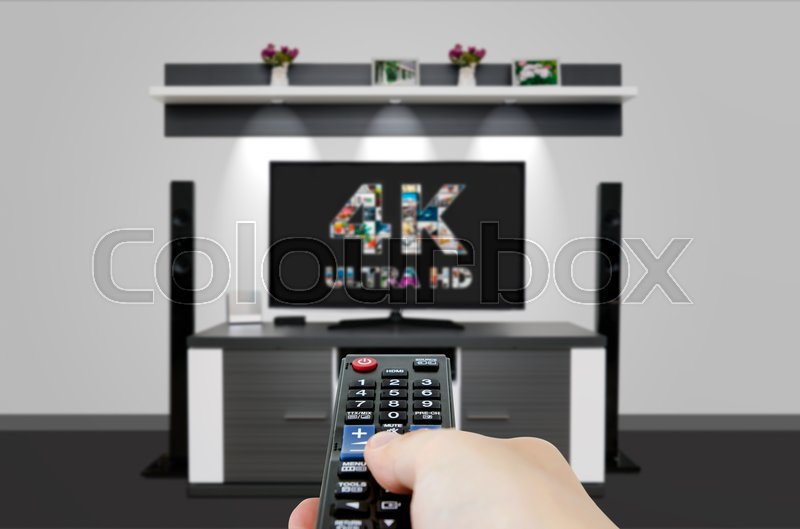 Stock image of 'TV ultra HD. 4K television resolution technology. Watch TV in home cinema.'