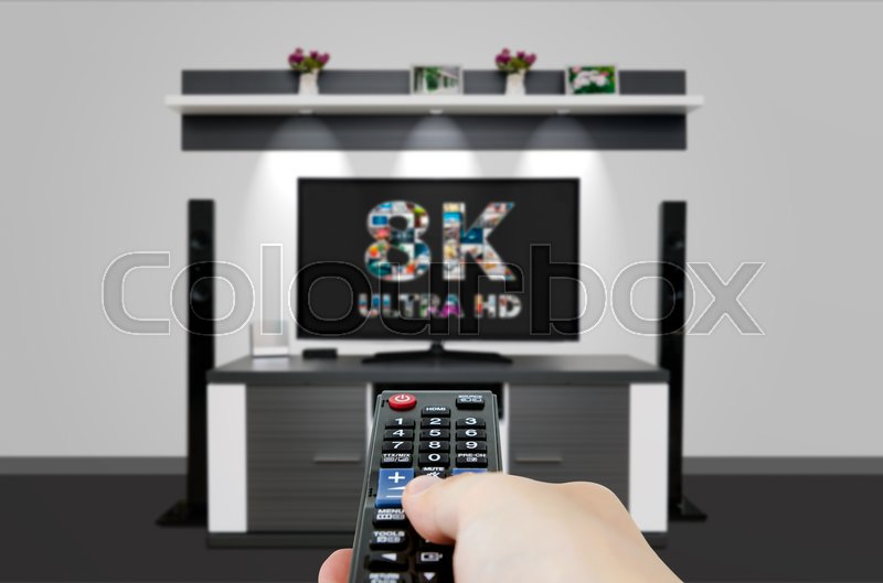 Stock image of 'TV ultra HD. 8K television resolution technology. Watch TV in home cinema.'