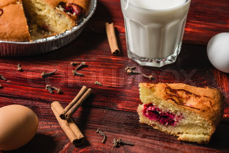 Stock image of 'Cherry cake with some ingredients and spices on redwood table'
