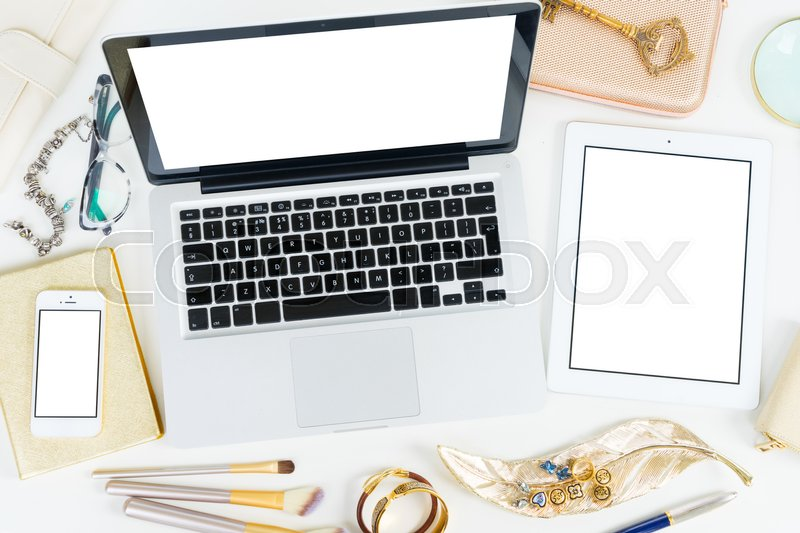 Stock image of 'Laptop, tablet and phone with golden woman accessories mock up flat lay styled scene, top view, copy space on blank screen background'