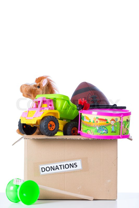 Stock image of 'Box of assorted toys to donate with white background'