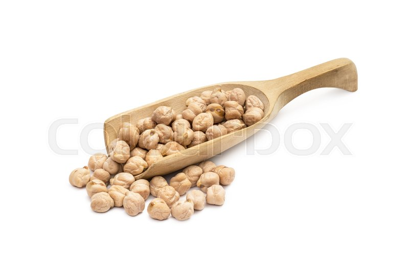 Stock image of 'Wooden spoon with chick peas and more chickpeas next to it on a white background'