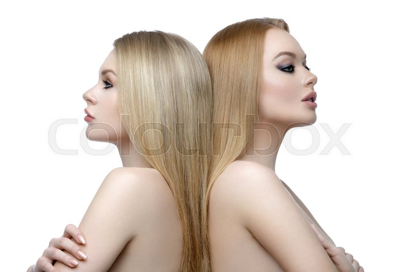 Stock image of 'Two beautiful girls with long blond straight hair and bright makeup. Isolated over white background. Closeup studio beauty shot.'