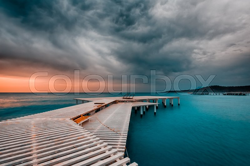 Stock image of 'Approaching storm over the Mediterranean Sea at the pier in Turkey'
