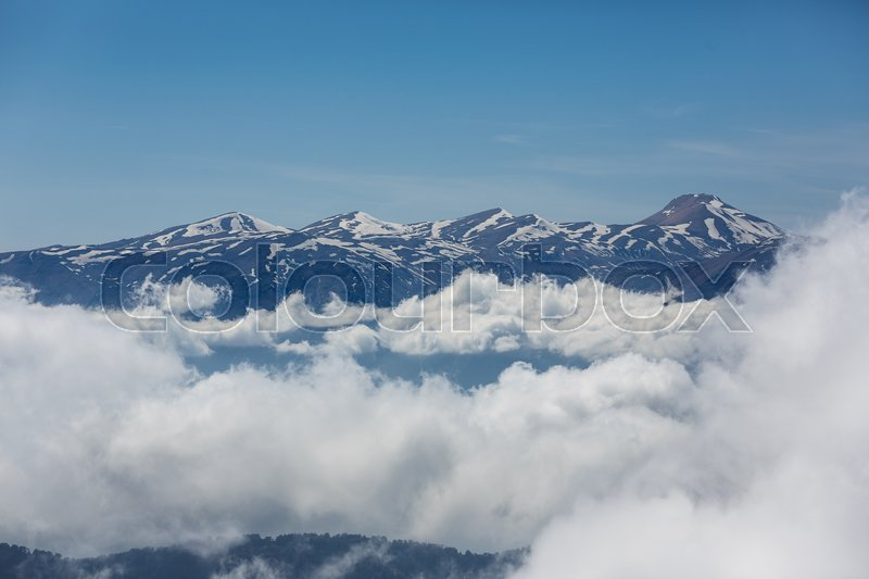 Stock image of 'View of the top of Tahtali mountain over white clouds'