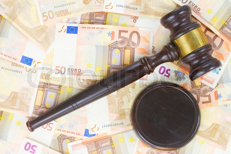 Stock image of 'Wooden Law Gavel and Euro Money Banknotes'