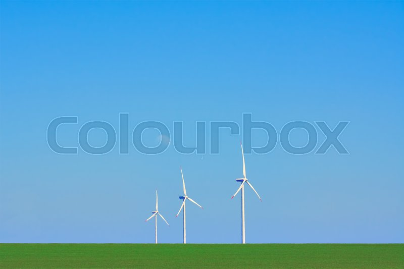 Stock image of 'Three Wind Turbines in heat haze against of Blue Sky'