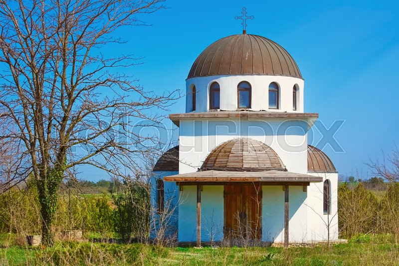 Stock image of 'Abandoned Monastery Church under the Blue Sky'