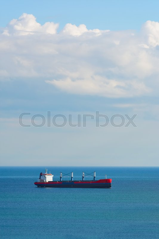 Stock image of 'Dry Cargo Ship in the Black Seanear'