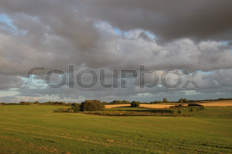 Stock image of 'Heavy clouds on the horizon in summer time'