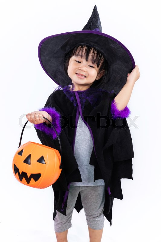 Stock image of 'Asian Chinese Liitle Girl Dressed As A Witch In Isolated White Background with Pumpkin.'