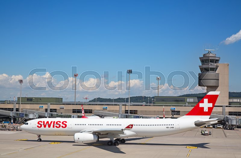 Stock image of 'ZURICH - July 30:  Planes preparing for take off at Terminal A of Zurich Airport on July 30, 2016 in Zurich, Switzerland. Zurich airport is home port for Swiss Air and one of the european hubs.'