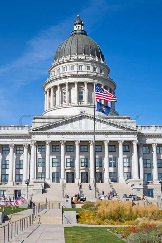 Editorial image of 'Salt Lake City, Utah, USA - October 8, 2016. Facade of the Utah State Capitol decorated with national flags.'