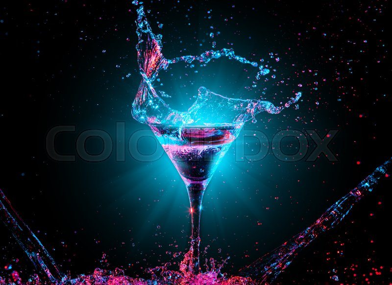 Stock image of 'Colourful cocktail in glass with splash on the dark background'