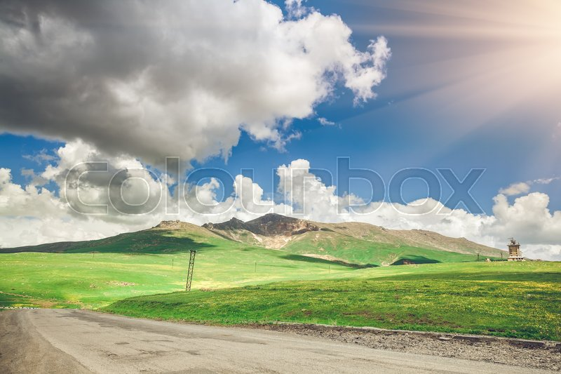 Stock image of 'View on road and blue sky with clouds. Exploring Armenia'