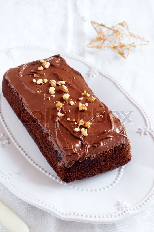 Stock image of 'Chocolate, rum and honey festive Christmas cake with walnuts - homemade chocolate Christmas pastry'