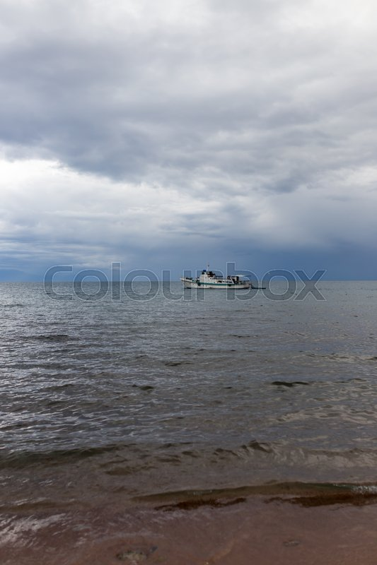 Stock image of 'Ship at sea in bad weather'