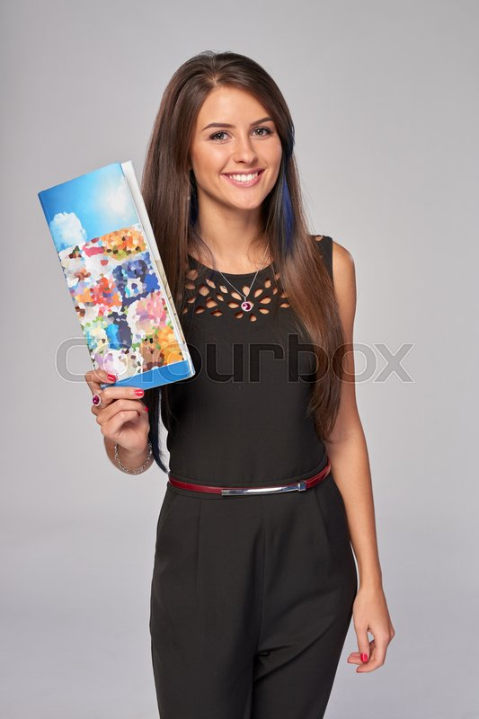 Stock image of 'Smiling business woman showing an advertising brochure'