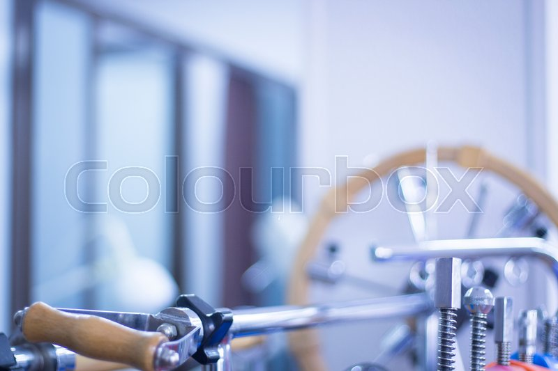 Stock image of 'Physical therapy equipment in physiotherapy clinic specialized in sports injury rehabilitation for wrists, hands and fingers.'