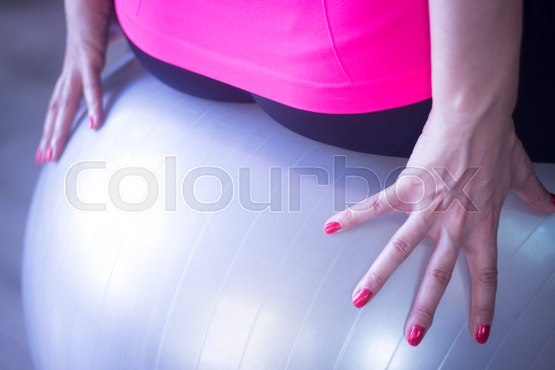 Stock image of 'Gym exercise pilates ball in fitness studio.'