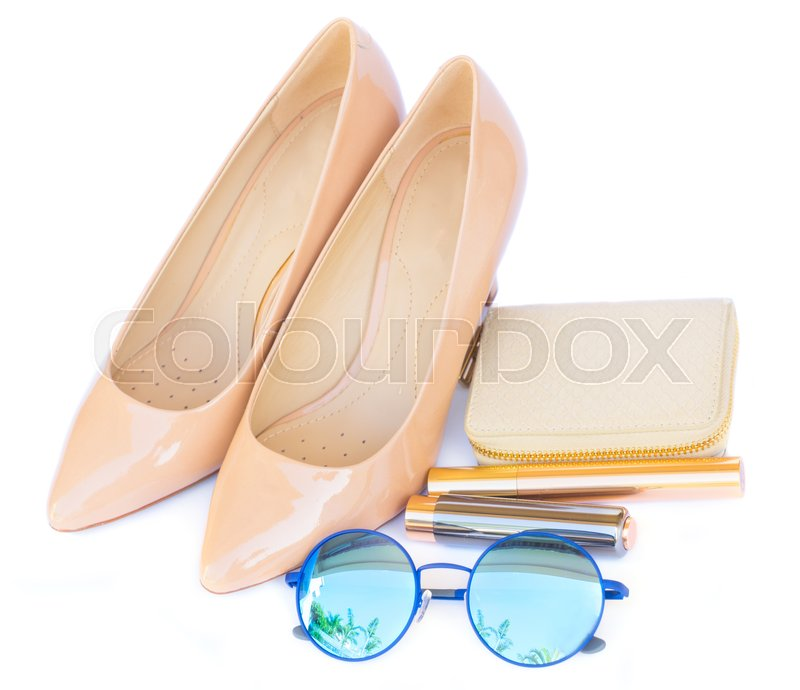 Stock image of 'Nude colored high heels still life with wallet, sun glasses and lipstick isolated on white background'