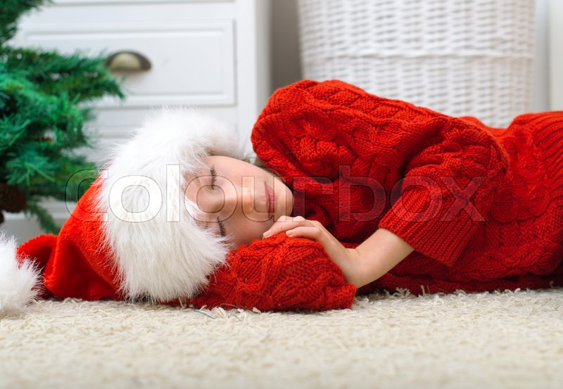 Stock image of 'Little girl was waiting for Santa Claus and fell asleep.'