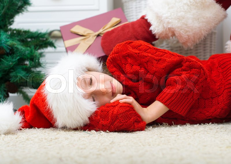 Stock image of 'Santa Claus delivering presents while kids are sleeping.'