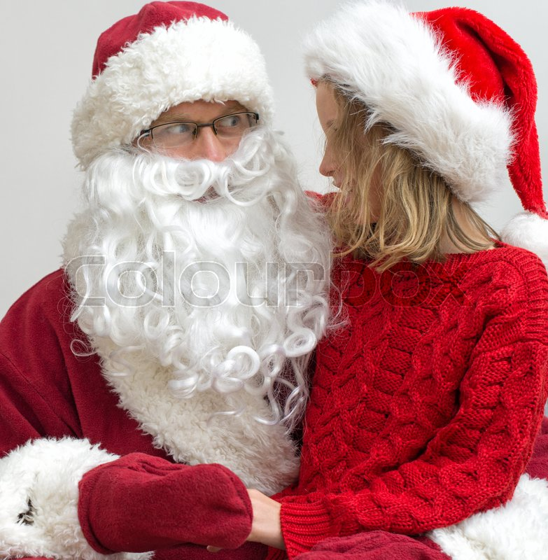Stock image of 'Happy smiling little girl with Santa Claus.'