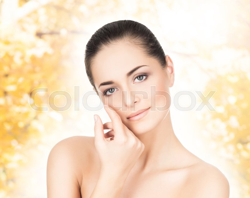 Stock image of 'Portrait of beautiful, fresh and healthy girl over seasonal autumn background.'
