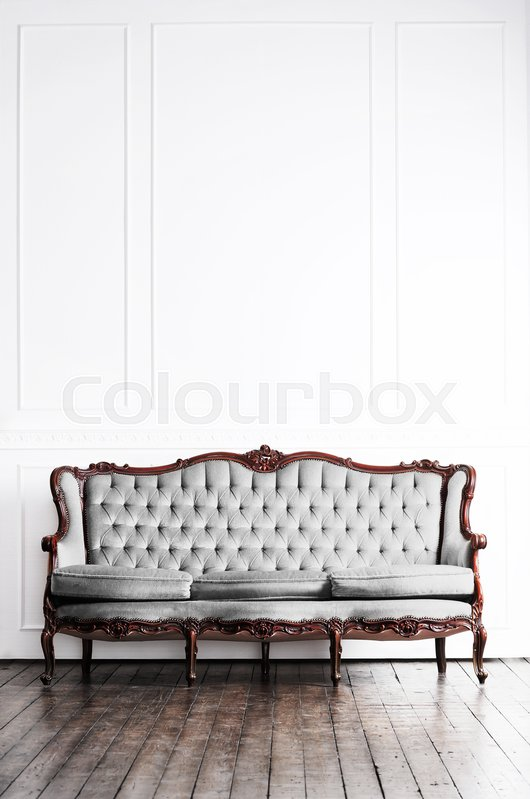 Stock image of 'Ancient sofa in a retro interior. Vintage background.'