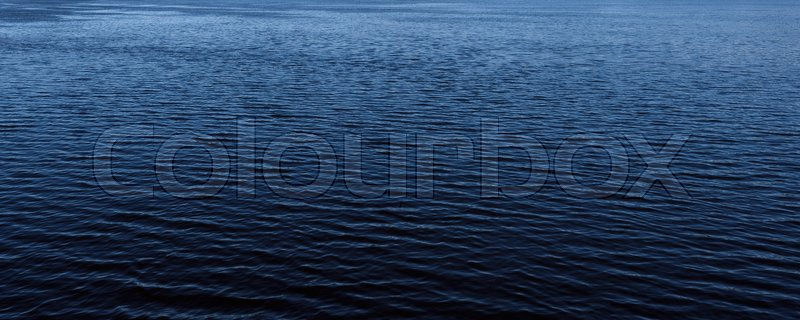Stock image of 'Abstract nature background. Water surface with small ripples'