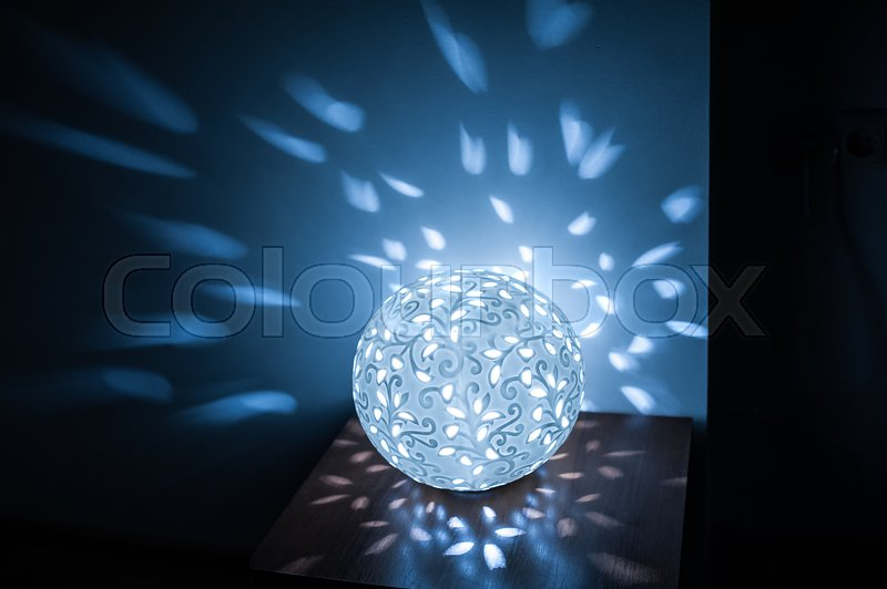Stock image of 'included lamp ball on table in kitchen with blue light.'