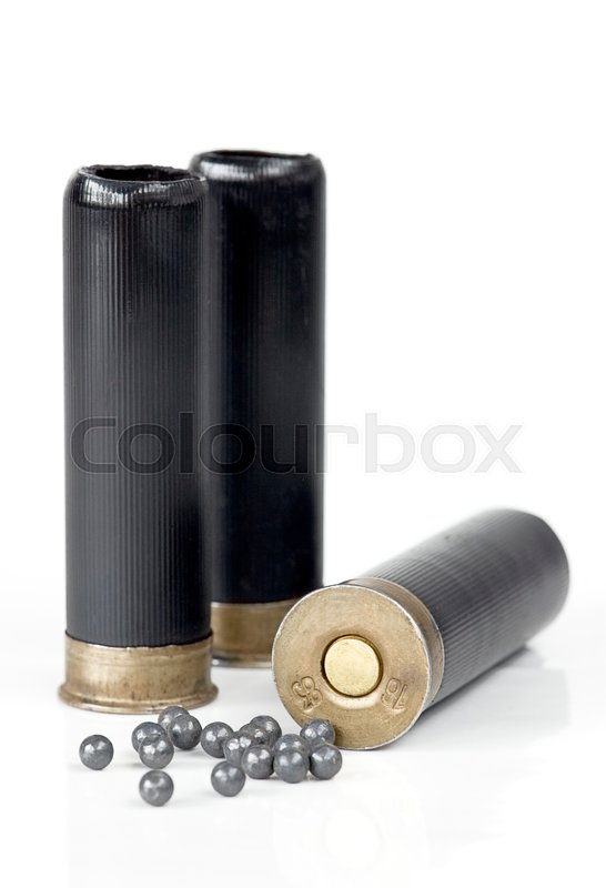 Stock image of 'three hunting cartridge and lead shot on a white background'