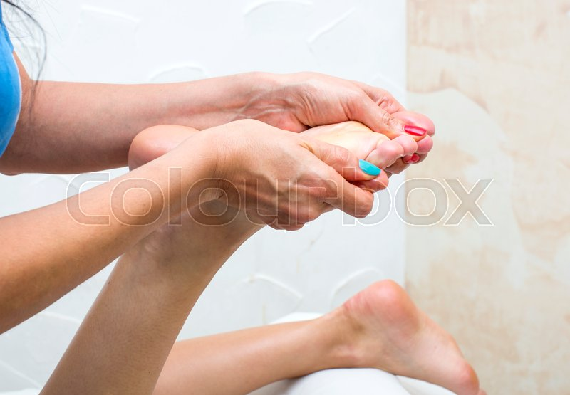 Stock image of 'The process of foot massage treatments in the beauty salon'