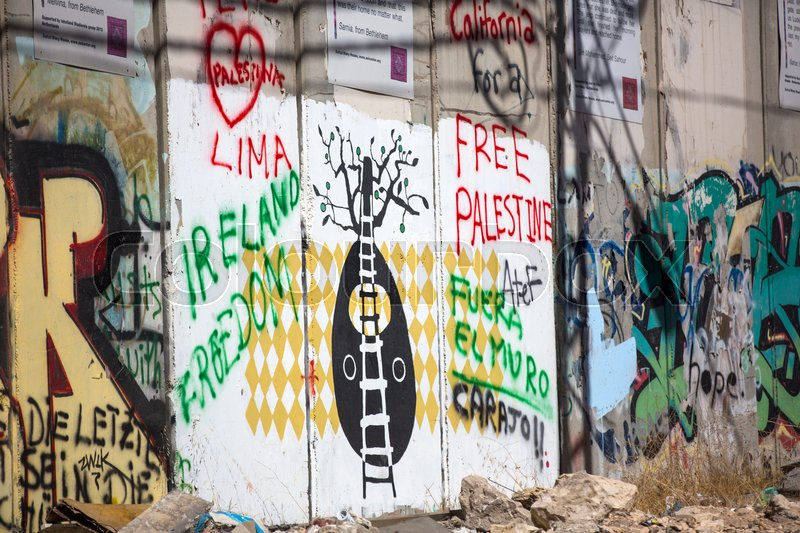 Editorial image of 'BETHLEHEM, PALESTINE - OCTOBER 7, 2016:  Detail of graffiti on the separation barrier between Palestine and Israel. Palestine - 2016'