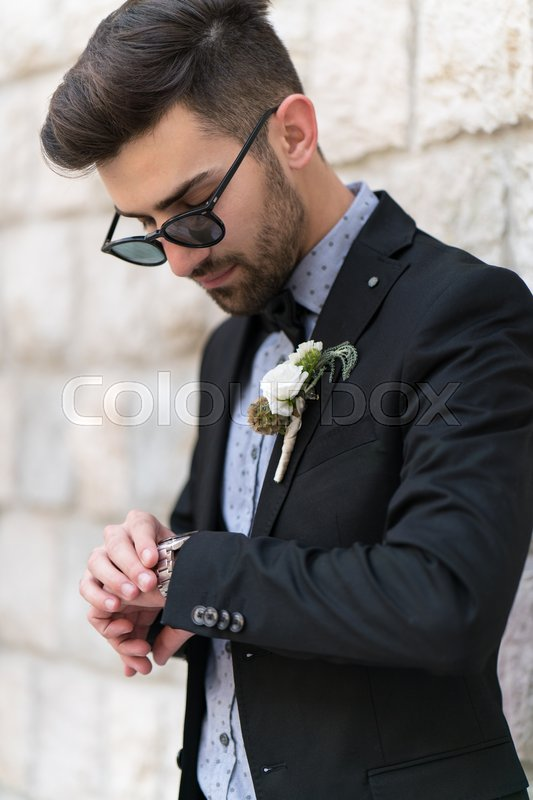 Stock image of 'Sexy man in tuxedo and bow tie posing'