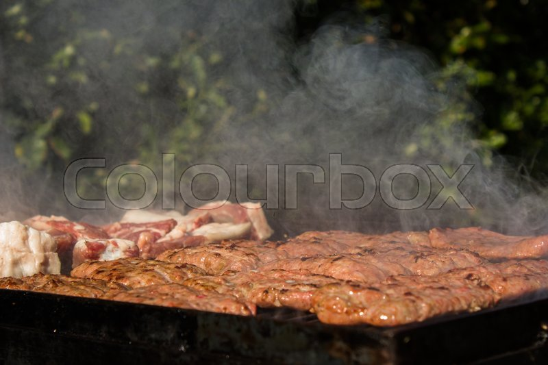 Stock image of 'Tasty cooked grilled red meat for the village festival'