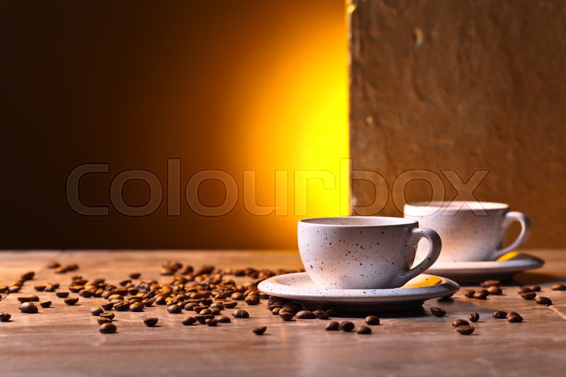 Stock image of 'Cups of black coffee and roasted beans'