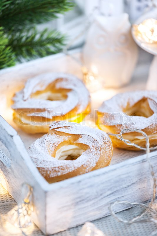 Stock image of 'Cream puff rings (choux pastry) on white christmas background'