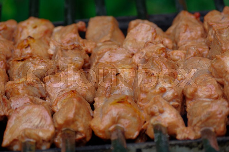 Stock image of 'Shashlik on skewers closeup, raw and cooked'